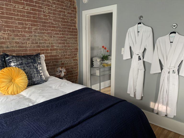 Schatzi Suite Bedroom with Queen Bed, luxury bedding, robes, slippers